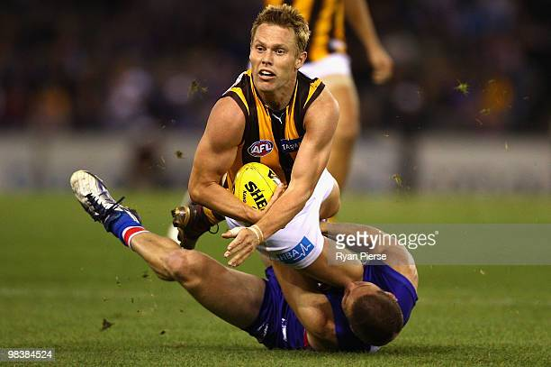 Sam Mitchell of the Hawks is tackled by Matthew Boyd of the Bulldogs during the round three AFL match between the Western Bulldogs and the Hawthorn...