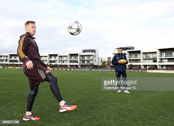 Sam Mitchell of the Hawks juggles the ball as Erik Lamela of Tottenham Hotspur looks on during a Tottenham Hotspur player visit to the Hawthorn Hawks...