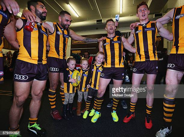 Sam Mitchell of the Hawks sing the club song with his kids after winning his 300th match during the round 18 AFL match between the Hawthorn Hawks and...