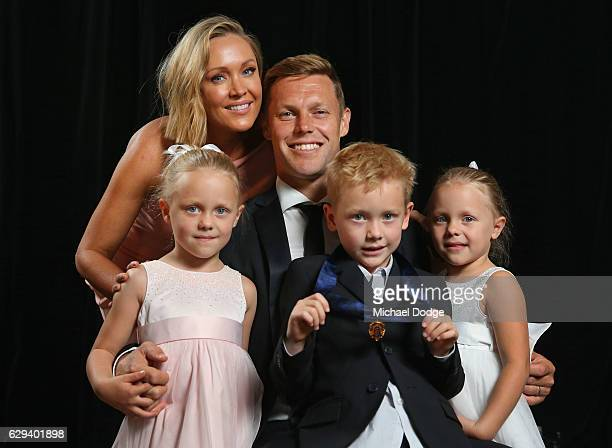 Sam Mitchell of the West Coast Eagles poses with wife Lyndall daughters Emmy and Scarlett and son Smith after receiving his Browlnow during the 2012...