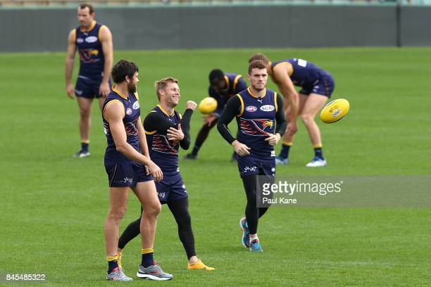 Sam MItchell works on a drill with Josh Kennedy and Luke Shuey during a West Coast Eagles AFL training session at Domain Stadium on September 11 2017...