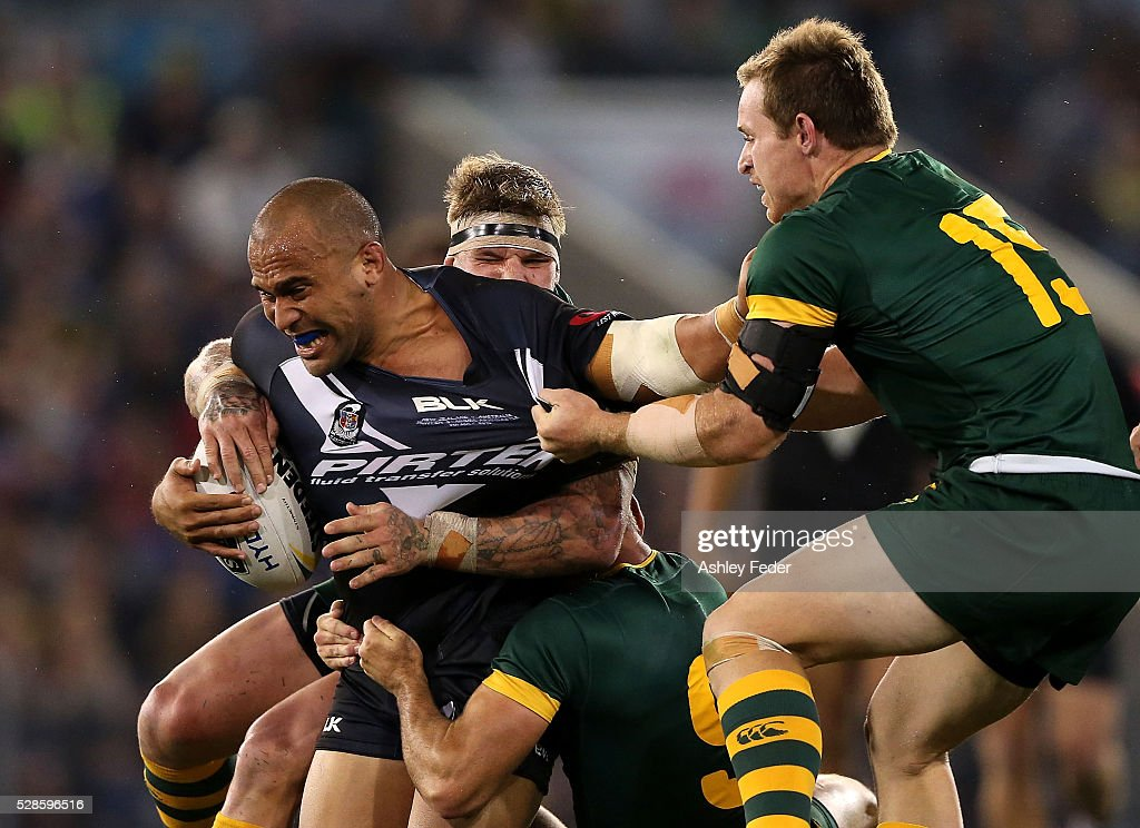 Sam Moa of the Kiwis is tackled by Michael Morgon of the Kangaroos during the International Rugby League Trans Tasman Test match between the Australian Kangaroos and the New Zealand Kiwis at Hunter Stadium on May 6, 2016 in Newcastle, Australia.