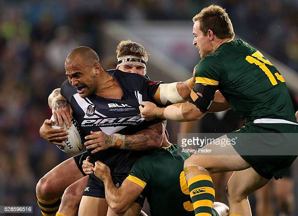 Sam Moa of the Kiwis is tackled by Michael Morgon of the Kangaroos during the International Rugby League Trans Tasman Test match between the...