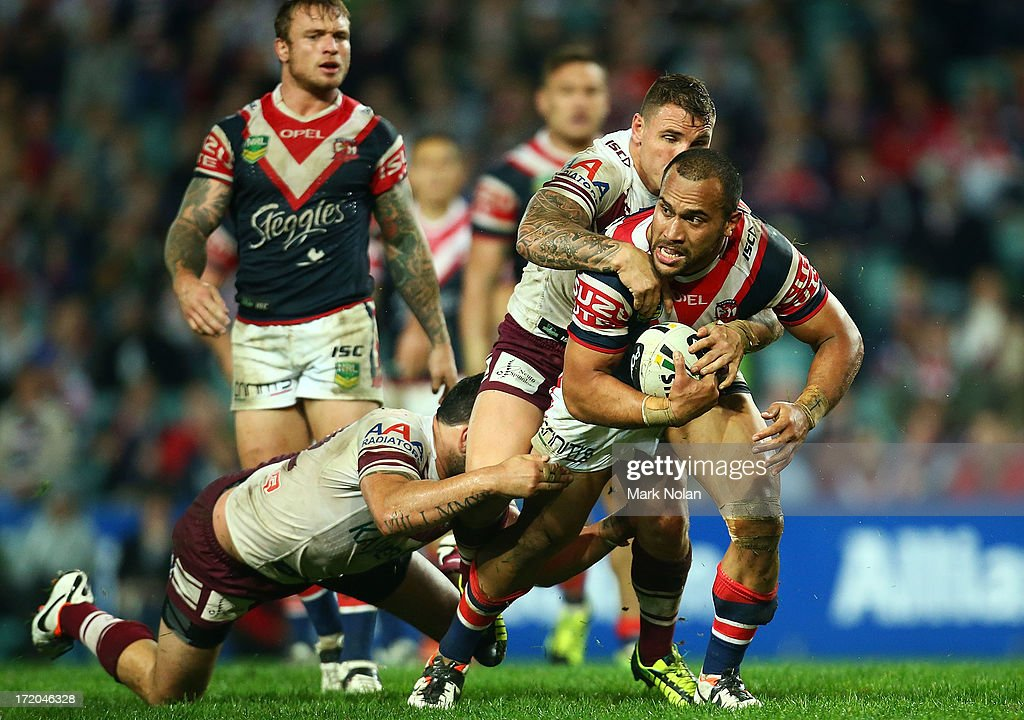 Sam Moa of the Roosetrs is tackled during the round 16 NRL match between the Sydney Roosters and the Manly Sea Eagles at Allianz Stadium on July 1, 2013 in Sydney, Australia.