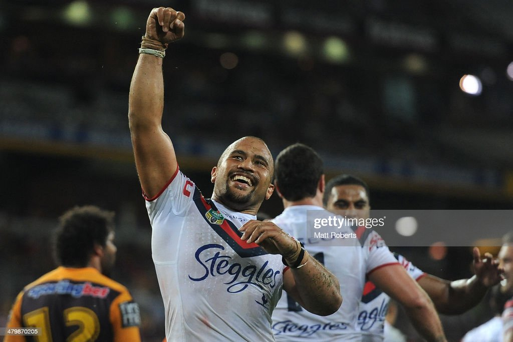 Sam Moa of the Roosters celebrates a try by Boyd Cordner during the round three NRL match between the Brisbane Broncos and the Sydney Roosters at Suncorp Stadium on March 21, 2014 in Brisbane, Australia.
