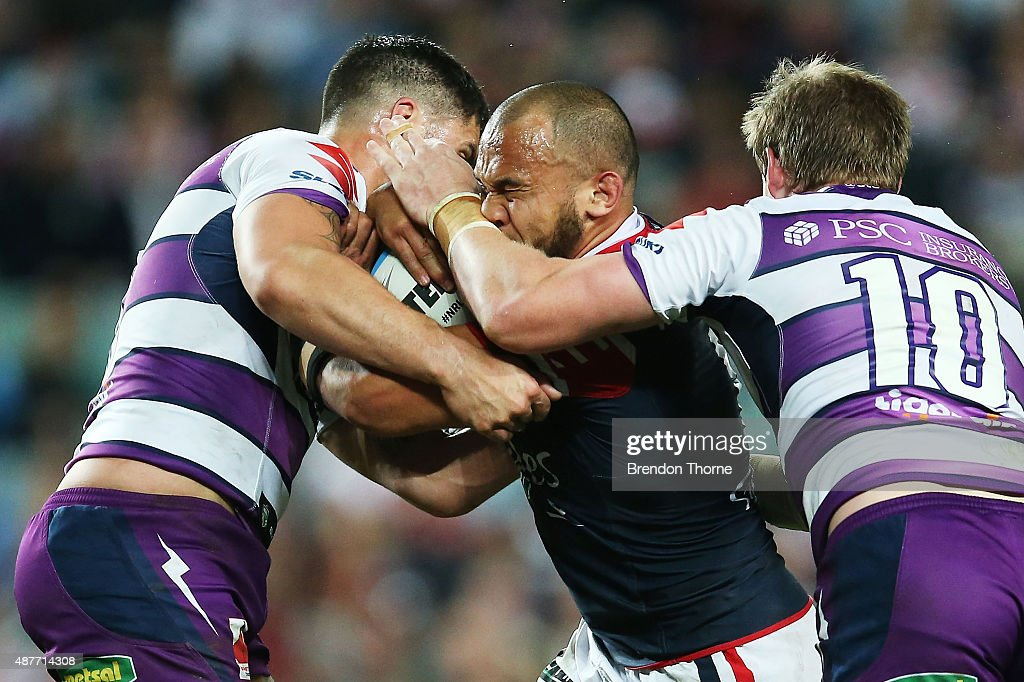 Sam Moa of the Roosters is tackled by Storm defence during the NRL qualifying final match between the Sydney Roosters and the Melbourne Storm at Allianz Stadium on September 11, 2015 in Sydney, Australia.