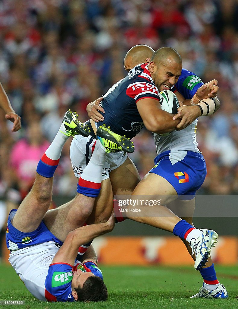 Sam Moa of the Roosters is tackled during the NRL Preliminary Final match between the Sydney Roosters and the Newcastle Knights at Allianz Stadium on September 28, 2013 in Sydney, Australia.