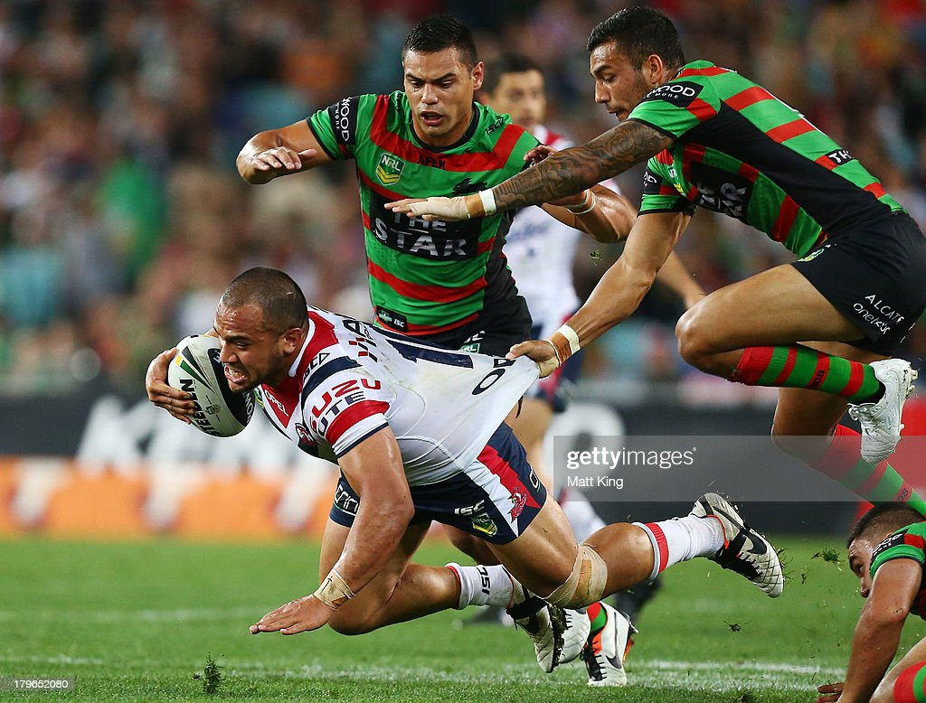 Sam Moa of the Roosters is tackled during the round 26 NRL match between the South Sydney Rabbitohs and the Sydney Roosters at ANZ Stadium on September 6, 2013 in Sydney, Australia.