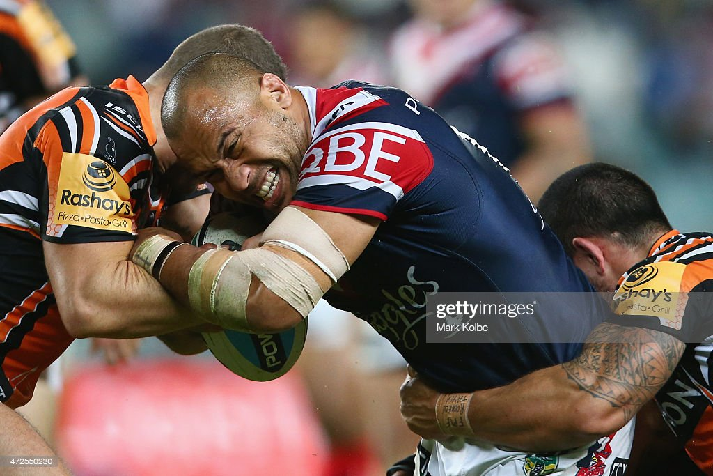 Sam Moa of the Roosters is tackled during the round nine NRL match between the Sydney Roosters and the Wests Tigers at Allianz Stadium on May 8, 2015 in Sydney, Australia.