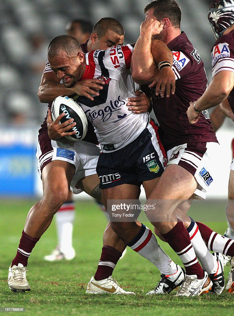 Sam Moa of the Roosters tries to break the Sea Eagles defence during the NRL trial match between the Manly Sea Eagles and the Sydney Roosters at Bluetongue Stadium on February 16, 2013 in Gosford, Australia.