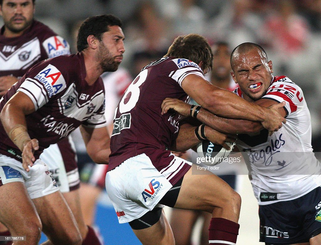 Sam Moa of the Rosters is tackled by the Sea Eagles defence during the NRL trial match between the Manly Sea Eagles and the Sydney Roosters at Bluetongue Stadium on February 16, 2013 in Gosford, Australia.