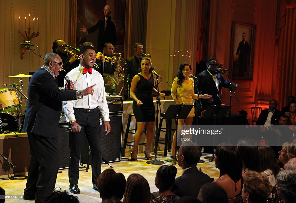 Sam Moore (L) and Joshua Ledet perform 'Soul Man' for President Barack Obama and first lady Michelle Obama (front row, C) during a concert of Memphis Soul music as part of the 'In Performance at the White House' series in the East Room of the White House April 9, 2013 in Washington, DC. Justin Timberlake was also scheduled to perform.