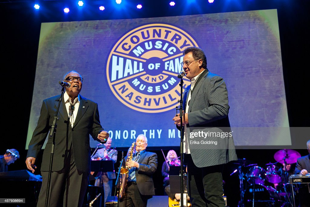 Sam Moore and Vince Gill perform during the 2014 Country Music Hall of Fame induction ceremony at Country Music Hall of Fame and Museum on October 26, 2014 in Nashville, Tennessee.