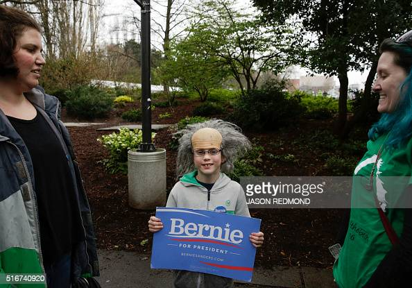 Sam Moore of Oak Harbor Washington waits in line with his mom Sarah Moore and family friend Fe Mischo to see Democratic presidential candidate Bernie...