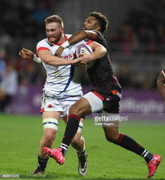 Sam Moore of Sale is tackled by Delon Armitage during the European Rugby Challenge Cup match between Lyon and Sale Sharks at Matmut Stade de Gerland...