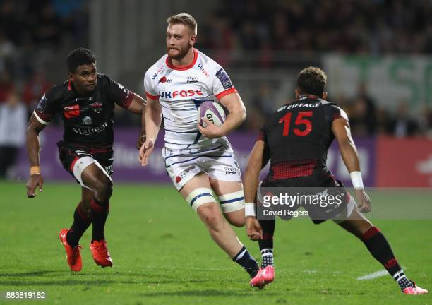 Sam Moore of Sale takes on Delon Armitage and moves away from Jone Tuva during the European Rugby Challenge Cup match between Lyon and Sale Sharks at...