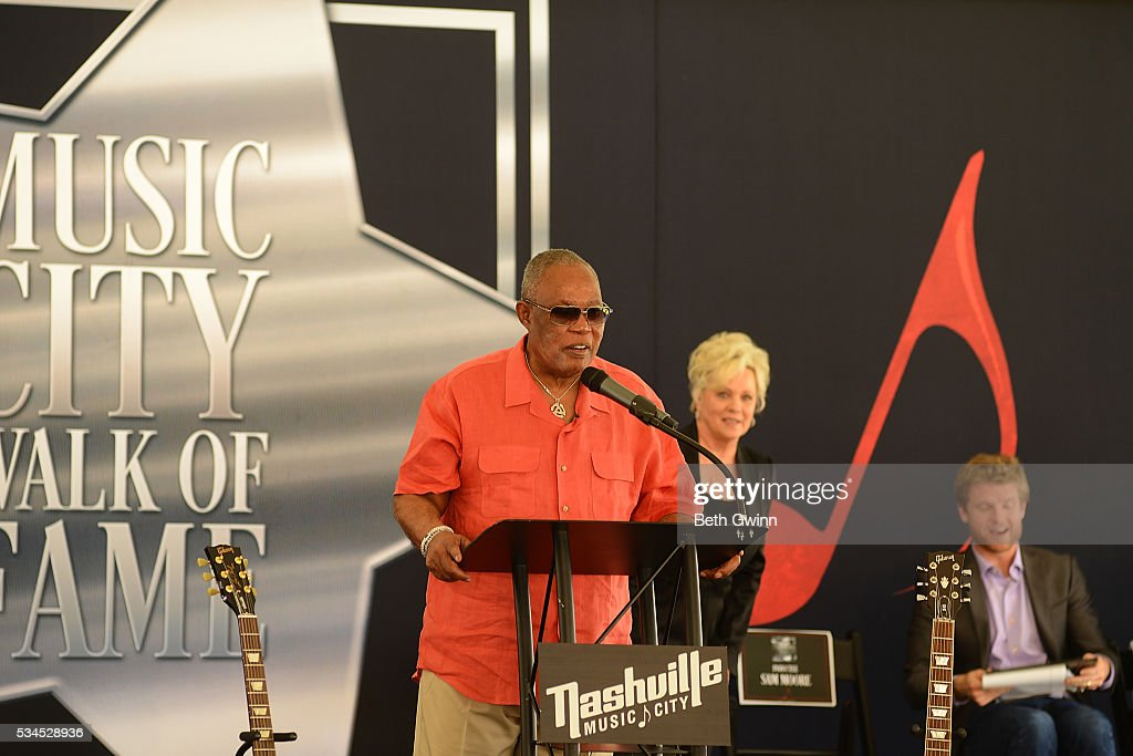 <a gi-track='captionPersonalityLinkClicked' href=/galleries/search?phrase=Sam+Moore&family=editorial&specificpeople=828179 ng-click='$event.stopPropagation()'>Sam Moore</a> receives a plaque at the Walk of Fame Park on May 26, 2016 in Nashville, Tennessee.