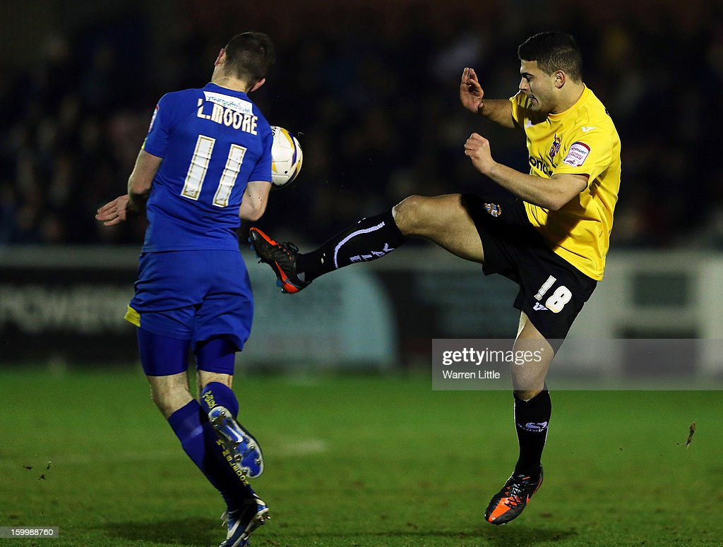 Sam Morsy of Port Vale tackles <a gi-track='captionPersonalityLinkClicked' href=/galleries/search?phrase=Luke+Moore&family=editorial&specificpeople=211020 ng-click='$event.stopPropagation()'>Luke Moore</a> of AFC Wimbledon during the npower League Two match between AFC Wimbledon and Port Vale at The Cherry Red Records Stadium on January 24, 2013 in Kingston upon Thames, England.