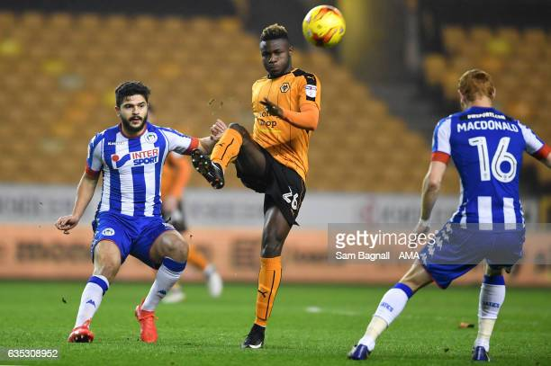 Sam Morsy of Wigan Athletic and Bright Enobakhare of Wolverhampton Wanderers during the Sky Bet Championship match between Wolverhampton Wanderers...
