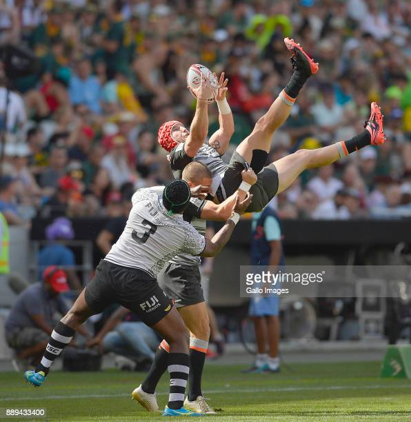 Sam Myers of Australia and Kalione Nasoko of Fiji during day 2 of the 2017 HSBC Cape Town Sevens at Cape Town Stadium on December 10 2017 in Cape...