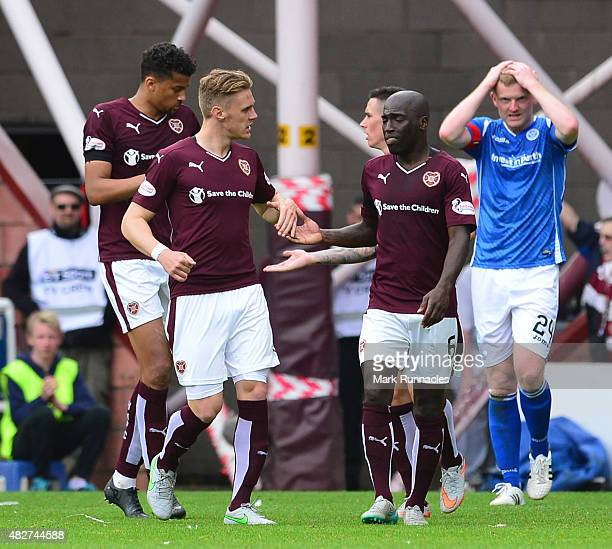 Sam Nicholson of Hearts celebrates with team mate Morgaro Gomis after scoring during the Ladbrokes Scottish Premiership match between Heart of...