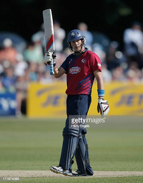 Sam Northeast of Kent acknowledges the crowd after reaching his half century during the Friends Life T20 match between Kent and Surrey at the St...