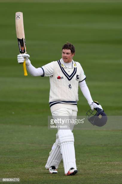 Sam Northeast of Kent celebrates after reaching his century during day three of the Specsavers County Championship Division Two match between Sussex...