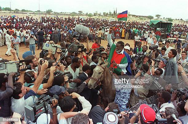 Sam Nujoma president of SWAPO sits on a horse that was given to him as a gift by the local community 05 November 1989 at SWAPO's last political rally...