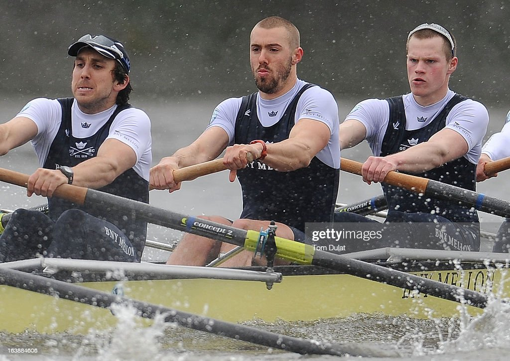 Sam O'Connor, Alex Davidson and Geordie Macleod of The Oxford Blue Boat in action during the training race against German Eight on the River Thames on March 17, 2013 in London, England.