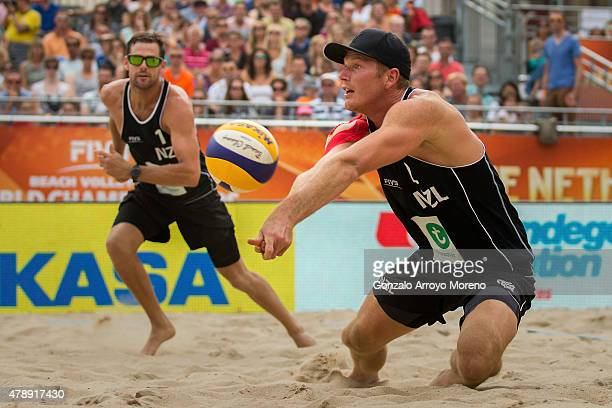 Sam ODea of New Zealand bumps the ball ahead his teammate Michael Watson during the FIVB Beach Volleyball World Championships male match between...