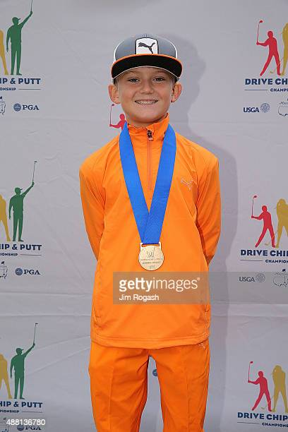 Sam O'Hara first place winner in the Boys 1011 Overall Competition poses with his medal during the 2015 Drive Chip and Putt Championship at The...