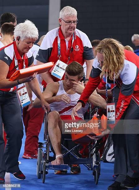 Sam Oldham of England is taken off the floor in a wheelchair after injuring himself during the Vault at the Gymnastics Artistic Team Final at SECC...