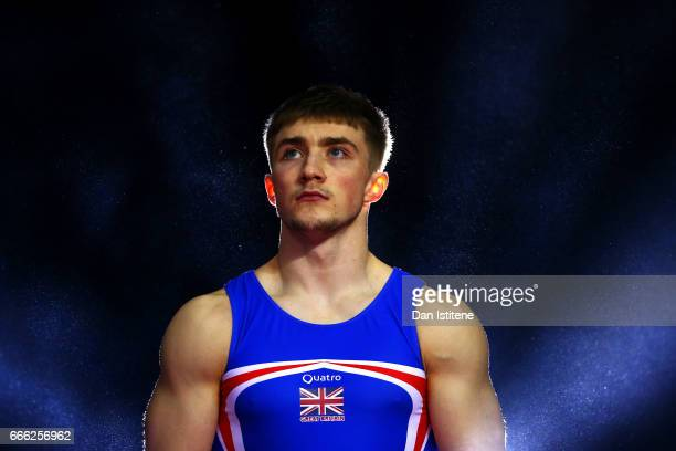 Sam Oldham of Great Britain walks in to the arena to compete in the men's competition for the iPro Sport World Cup of Gymnastics at The O2 Arena on...