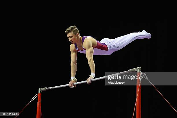 Sam Oldham of Loughborough competes in the Horizontal Bar during day two of the Mens Womens Artistic British Championships 2015 at the Echo Arena on...