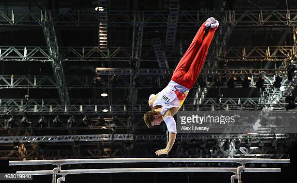 Sam Oldham of Loughborough competes on the parallel bars during the Men's Artistic Masters on day three of the Mens Womens Artistic British...