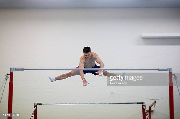Sam Oldham of the British Gymnastics Team performs on the High Bar during a training session at Lilleshall National Sports Centre on March 8 2016 in...