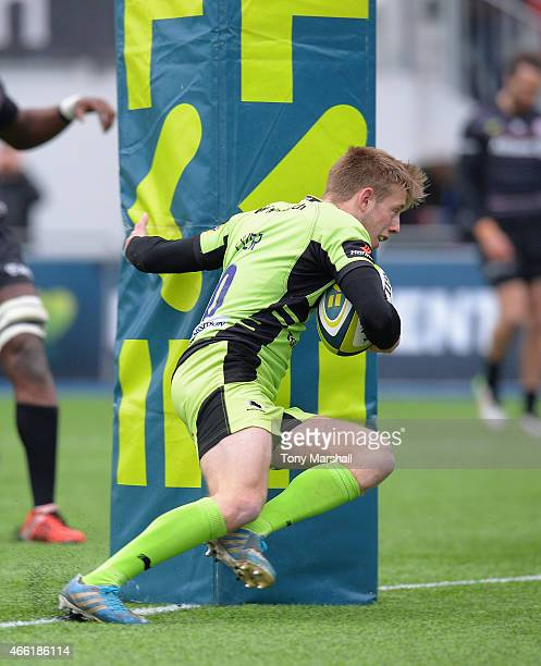 Sam Olver of Northampton Saints rounds the post to score a try during the LV= Cup Semi Final match between Saracens and Northampton Saints at Allianz...
