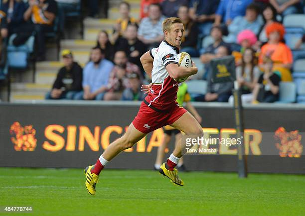 Sam Olver of Northampton Saints runs in to score a try during the Singha Premiership Rugby 7s Series Coventry at Ricoh Arena on August 21 2015 in...
