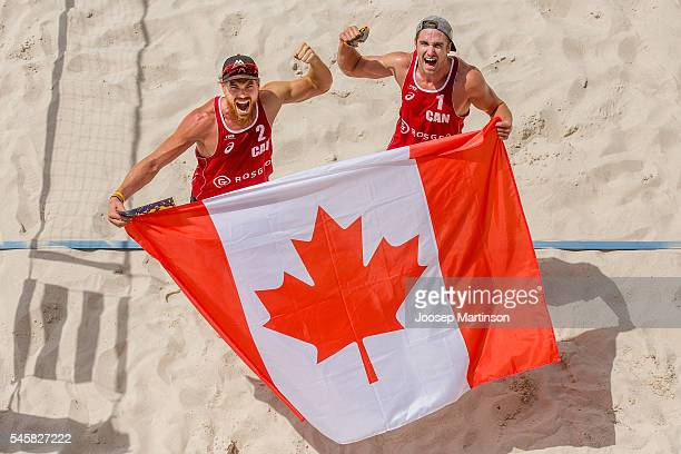 Sam Pedlow and Grant O'Gorman of Canada celebrate after winning the golden set and claiming ticket to Rio Olympics during FIVB World Continental Cup...