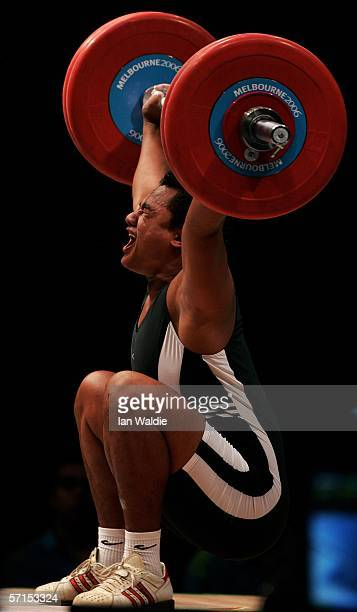 Sam Pera Jr of the Cook Islands starts to fall backwards as he competes in the snatch element of the men's 105kg weightlifting at the Melbourne...