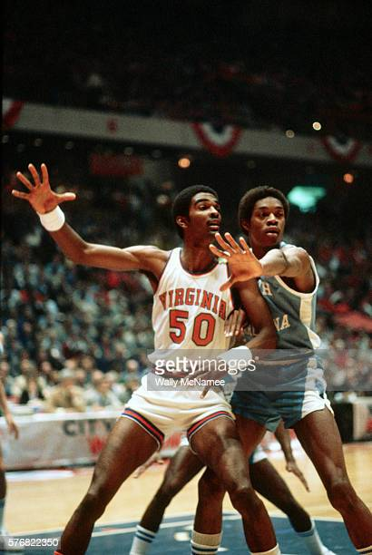 Sam Perkins of the North Carolina Tar Heels guards Ralph Sampson of the Virginia Cavaliers during a game in the NCAA Final Four
