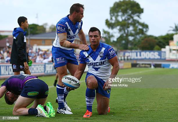 Sam Perrett of the Bulldogs celebrates his try with Josh Reynolds during the NRL Trial match between the Canterbury Bulldogs and the Melbourne Storm...
