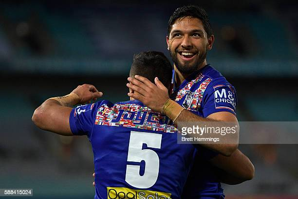 Sam Perrett of the Bulldogs celebrates with Curtis Rona of the Bulldogs after scoring a try during the round 23 NRL match between the Canterbury...