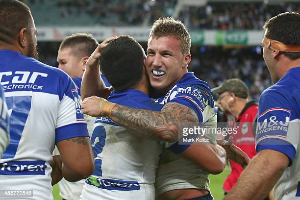Sam Perrett of the Bulldogs embraces Trent Hodkinson of the Bulldogs as they celebrate victory after Trent Hodkinson kicked the winning field goal in...