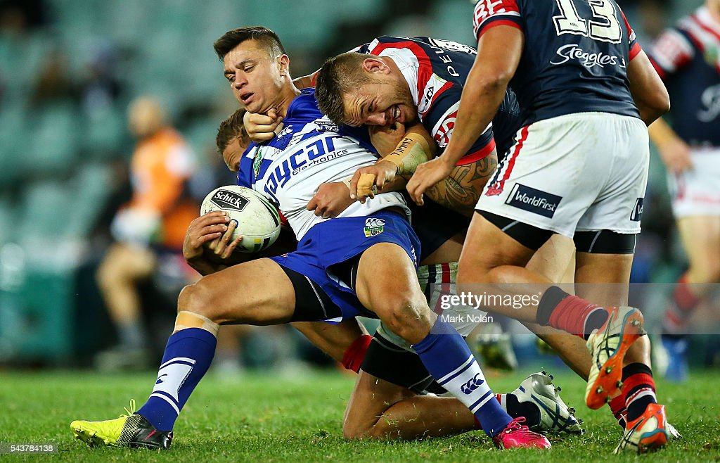 Sam Perrett of the Bulldogs is tackled during the round 17 NRL match between the Sydney Roosters and the Canterbury Bulldogs at Allianz Stadium on June 30, 2016 in Sydney, Australia.