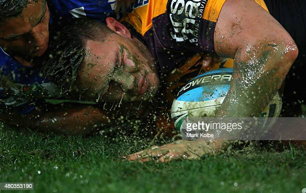 Sam Perrett of the Bulldogs tackles Daniel Vidot of the Broncos during the round 18 NRL match between the Canterbury Bulldogs and the Brisbane...