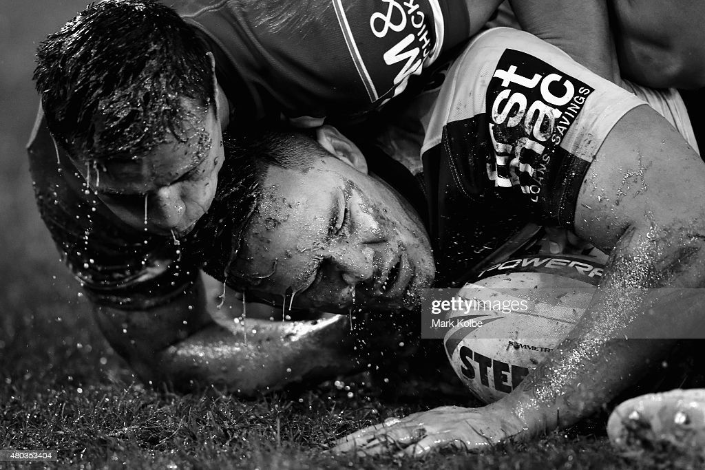 Sam Perrett of the Bulldogs tackles Daniel Vidot of the Broncos during the round 18 NRL match between the Canterbury Bulldogs and the Brisbane Broncos at ANZ Stadium on July 11, 2015 in Sydney, Australia.
