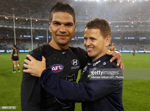 Sam PetrevskiSeton and Brendon Bolton Senior Coach of the Blues celebrate during the 2017 AFL round 03 match between the Carlton Blues and the...