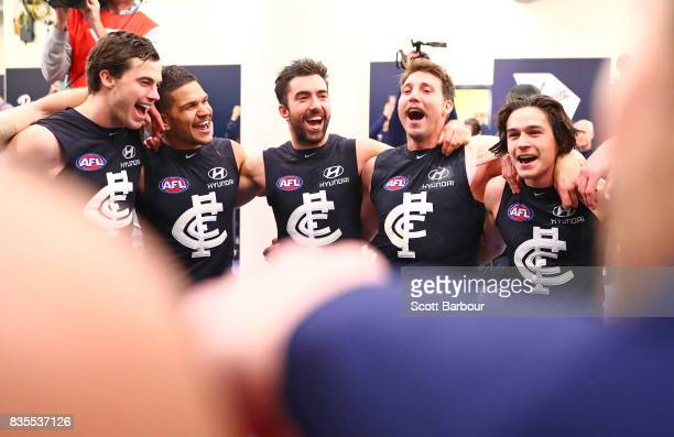 Sam PetrevskiSeton of the Blues and his teammates sing the song in the rooms after winning during the round 22 AFL match between the Carlton Blues...