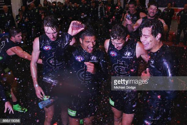 Sam PetrevskiSeton Tom Williamson and Jack Silvagni of the Blues of the Blues celebrate the win with teammates during the round three AFL match...
